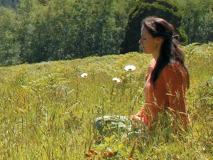 woman meditating in a field