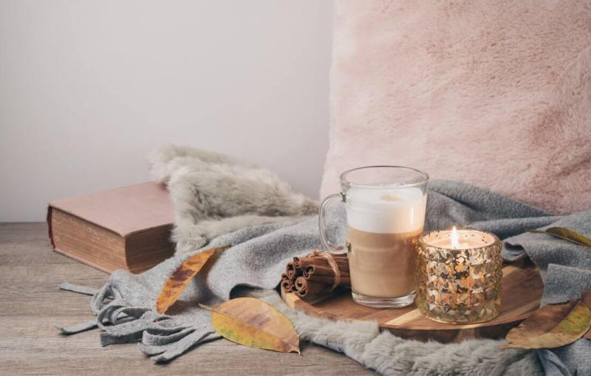 hygee corner with candle and plush pillow