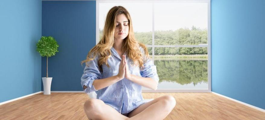 woman in blue meditation space