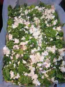 Adding Spinach filling to the corn pie casserole