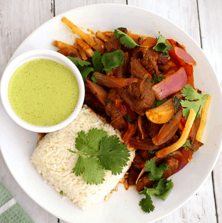 Peruvian Lomo Saltado - Beef Stir Fry Served with Salsa Verde, Rice and French Fries