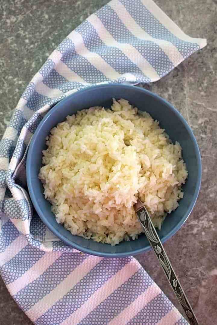 Olive Oil & Garlic Jasmine Rice - picture shows a bowl of ready to serve rice. Usually I serve this rice as a side dish to stews and roasted meats.