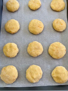 Cookies on a parchment paper, ready to bake. I keep them at least about an inch apart.