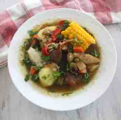 A plate of Christmas Soup, Bolivian Picana. Soup is hearty and has both chicken and beef.