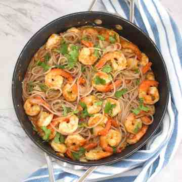 Skillet with quinoa pasta and shrimp tomato sauce