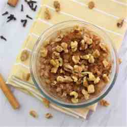A bowl with farro pudding topped with walnuts and cinnamon