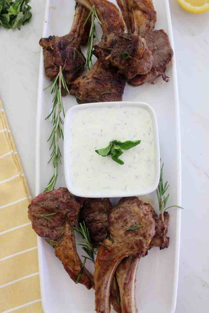 Platter of just grilled lamb chops served with tzatziki dip.