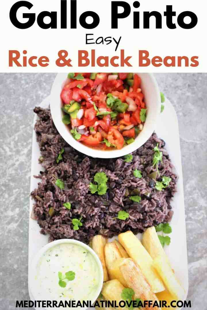 A platter of rice and black beans, shown with a tomato side dish and fried yucca with a yogurt dip.