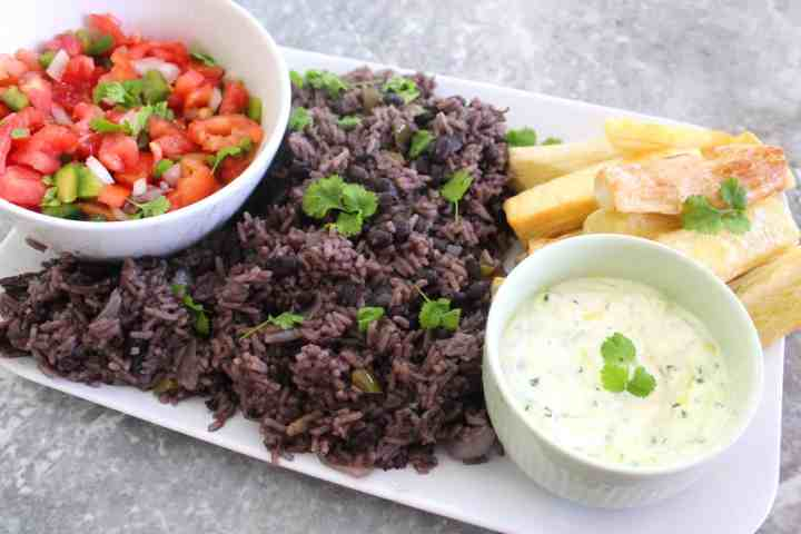Family style rice and black beans dinner, shown with 2 side dishes.