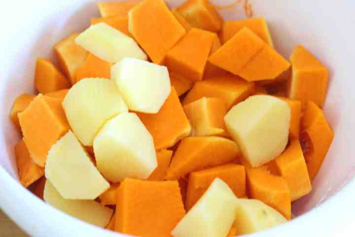 Chopped potatoes and butternut squash ready to cook.