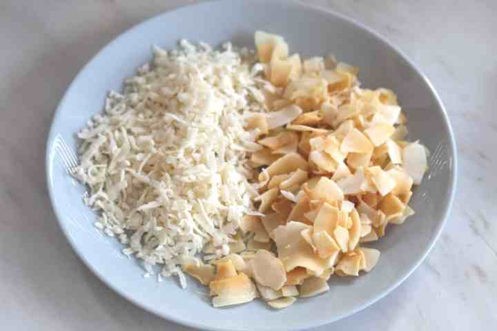 Coconut Flakes and Coconut Chips on a plate next to each other. I use both of them as toppings for the flan.