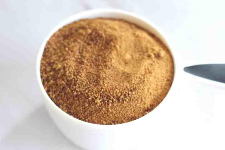 Coconut sugar in a measuring cup