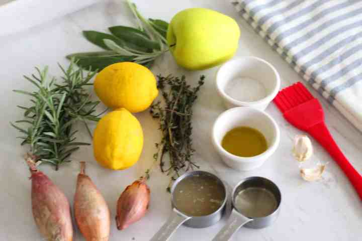 Ingredients needed to roast turkey breast: rosemary, sage, thyme, lemons, apple, coarse salt, olive oil, shallots, garlic chicken stock and white wine.