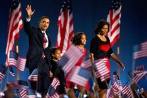 Barack Obama waves on stage with wife Michelle and daughters Malia and Sasha as he walks to give his victory speech at Grant Park after becoming the country's first black president. Thousands of people attended the historic event at Grant Park in Chicago on November 4, 2008. Photo by Patrick T. Fallon