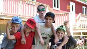 campers with a staff member outside their cabin