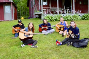campers practicing guitar