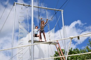 campers learning the trapeze at circus arts