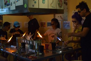 campers working with blow torches