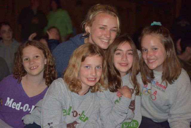 staff with her campers at an evening event