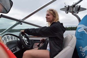 staff member driving the speed boat