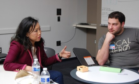 Dr. Jennifer M. Joe, MD mentors one of the Boston Blue Button Innovation Challenge teams. Photo credit: Ajay Major.