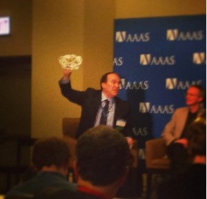 Peter Coveney holds up a 3D printed model of HIV at the 2014 AAAS Meeting.