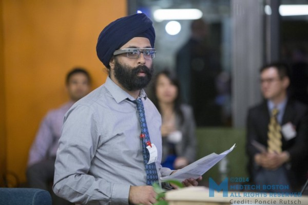 Karandeep Singh, MD, leader of Brigham and Women Hospital's first Google Glass application, does a live demos of the technology to efficiently search through patient data on Glass, sharing Glass's screen with the audience in real time. Photo by Poncie Rutsch.