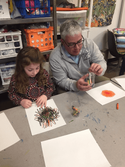 Superintendent Armand Pires, right, works on a coloring assignment with first grade student Kylie Babineau. (Courtesy Photo Medway Public Schools)