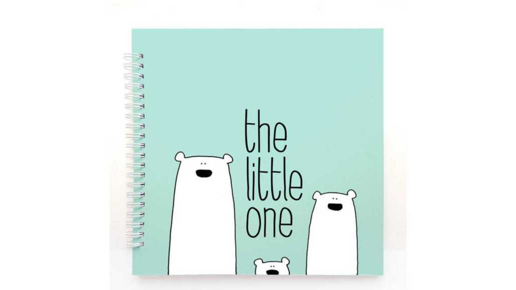 Spiral bound mint coloured The Little One baby memory book with cartoon polar bear family.