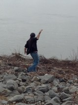 He missioned down the bank to go touch the water