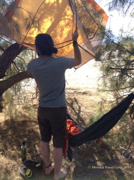 Nope, he's not setting up the tent... Kiernan is organizing a little shade for his hammock.