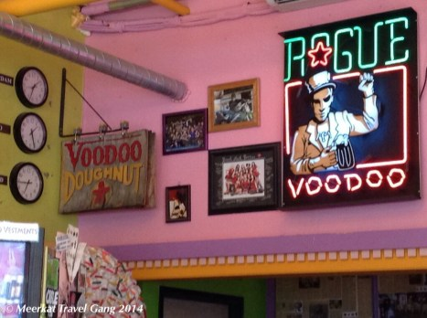 The inside of the shop is bright pink, decorated with crazy pictures and creative boards, posters and merchandise. And doughnuts.