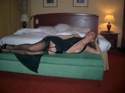 MeetLocalMILFs.Online - MILF Dating Site - Amateur Photo Of Sexy Elegant Wife Wearing Lingerie And Seductively Posing On Bed For Her Lucky Husband.