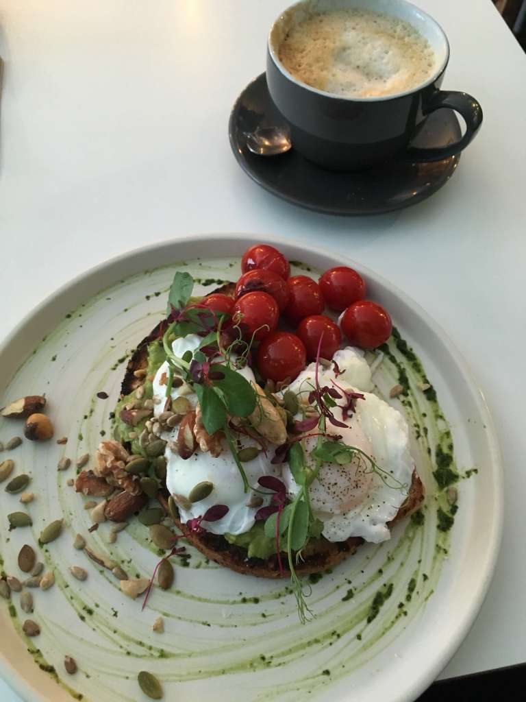 Smashed Avocado on toast with a poached egg , at Nibble Cafe