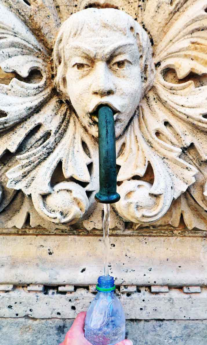 The waterfountains inside Dubrovnik Old Town are suitable for drinking from. This is me filling up my water bottle