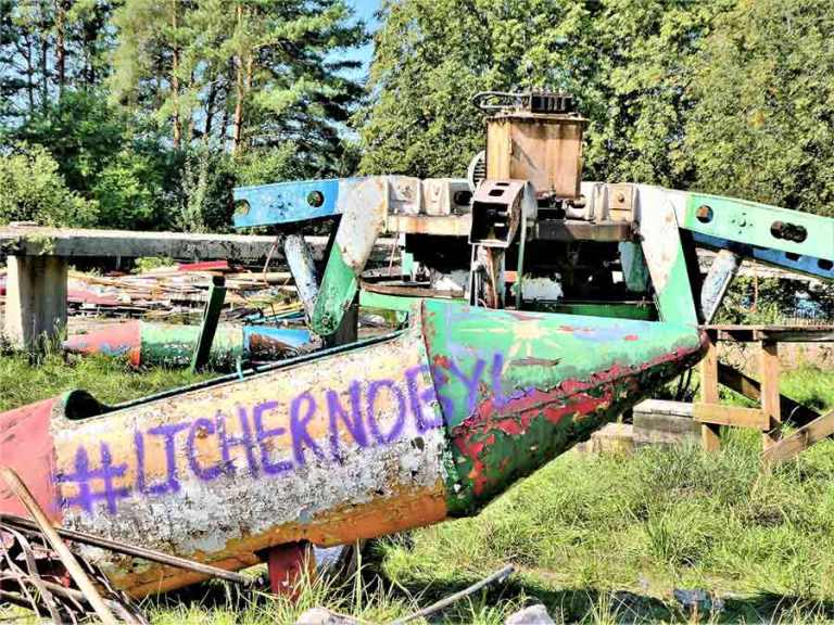 A rocket at the abandoned amusement park in Elektrenai, with the grafitti #LTChernobyl