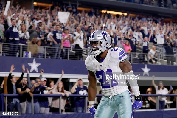 ARLINGTON, TX - DECEMBER 26: Ezekiel Elliott #21 of the Dallas Cowboys celebrates after scoring a touchdown against the Detroit Lions in the first quarter at AT&T Stadium on December 26, 2016 in Arlington, Texas. (Photo by Tom Pennington/Getty Images)