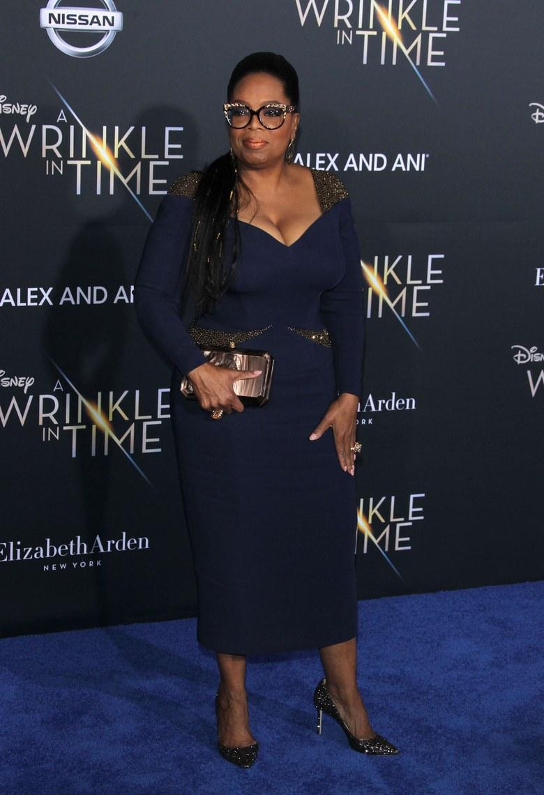Oprah Winefrey wearing Altelier Versace at the A Wrinkle in Time premiere via Shutterstock