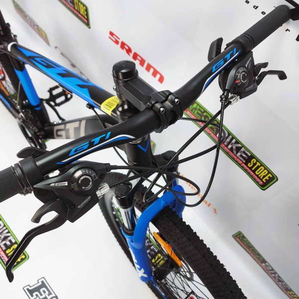 Bicicleta-guayaquil-mtb-montañera-talla-mega-bike-store-bike-shimano-gti-madrock-aluminio-aro-26-negro-azulVVVVV