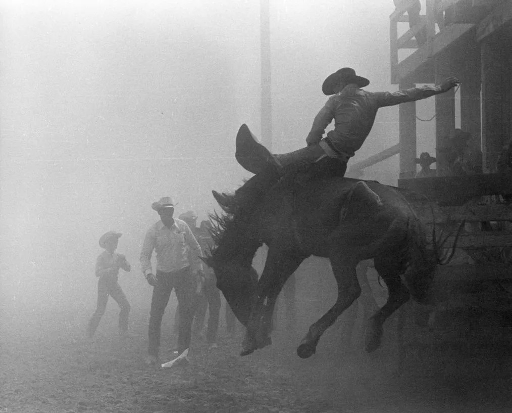 Skeeter Humble in a dust storm. Chandler, Arizona. 1964. Louise Serpa :: Courtesy Tucson Rodeo Committee