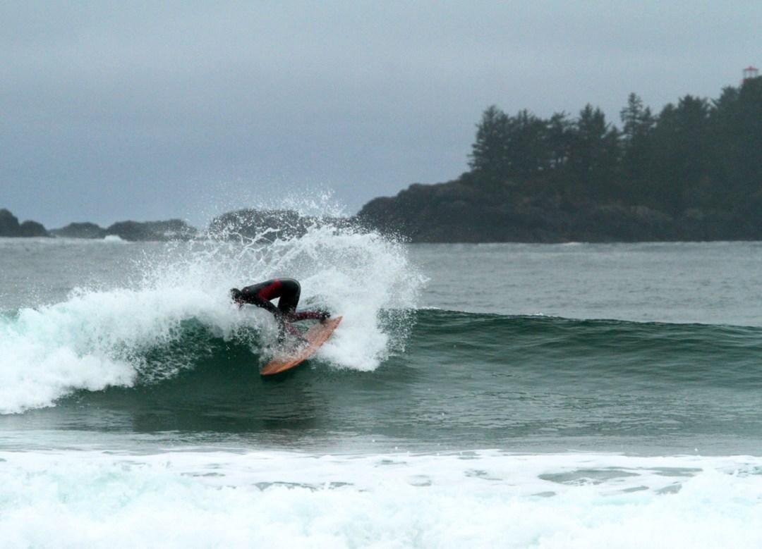Raph Rruhwiler riding a Wefi board in Tofino. Photo By Adam Dewolfe.