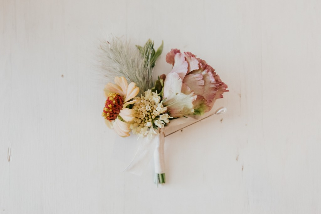 Megan Claire Photography | Northern California Wedding Photographer. Grooms boutonnière with yellow and pink flowers photos @meganclairephoto