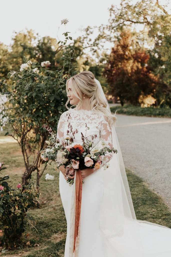Megan Claire Photography | Northern California Wedding Photographer. Outdoor fall farm wedding flower bouquet with orange, pink, yellow and white flowers @meganclairephoto