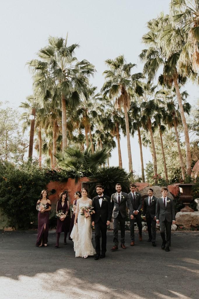 Megan Claire Photography | Arizona Wedding Photographer. Vintage inspired greenhouse arboretum wedding. Bridal party in purple and black @meganclairephoto