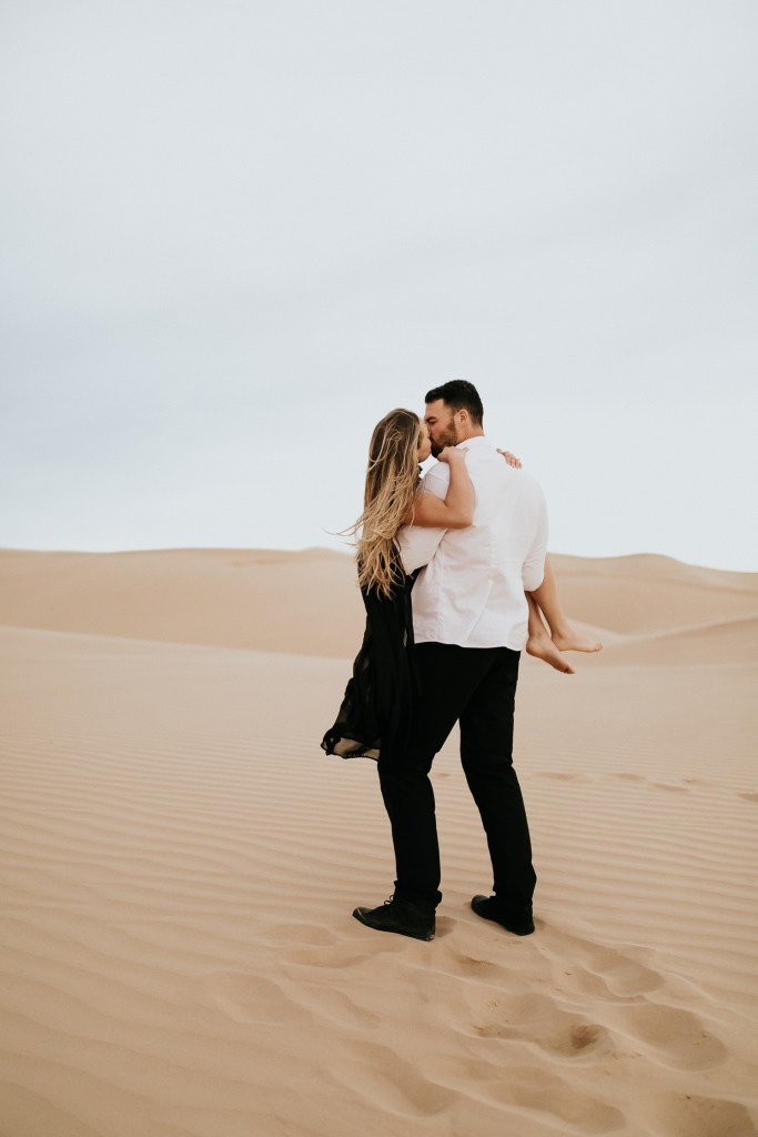 Megan Claire Photography | Phoenix Arizona Portrait, Couples and Wedding Photographer. Adventurous windy sand dunes engagement photoshoot @meganclairephoto