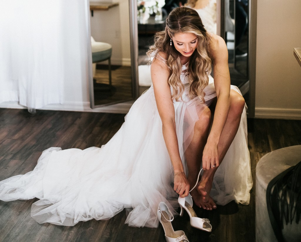 Megan Claire Photography | Arizona Wedding Photographer. Beautiful winter wedding in the desert at the Paseo in Apache Junction, Arizona near superstition mountains. Bride getting ready on wedding day