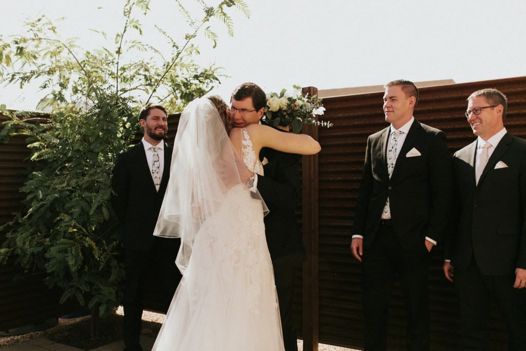 Megan Claire Photography | Arizona Wedding Photographer. Beautiful winter wedding in the desert at the Paseo in Apache Junction, Arizona near superstition mountains. Brides first look with father and brothers