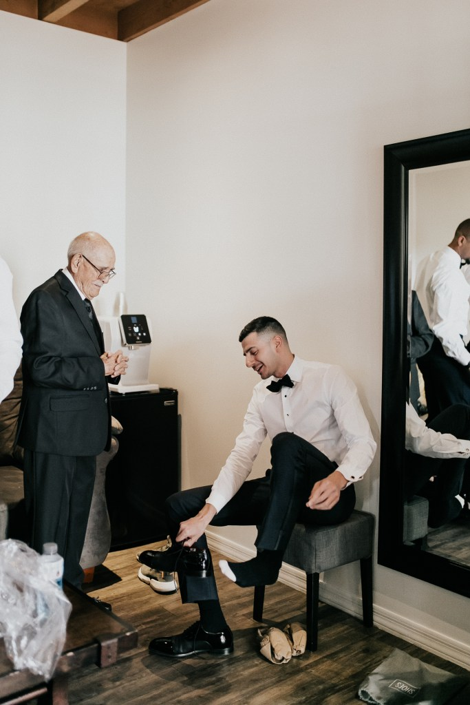Megan Claire Photography | Arizona Wedding Photographer. Beautiful winter wedding in the desert at the Paseo in Apache Junction, Arizona near superstition mountains. Groom getting ready on wedding day