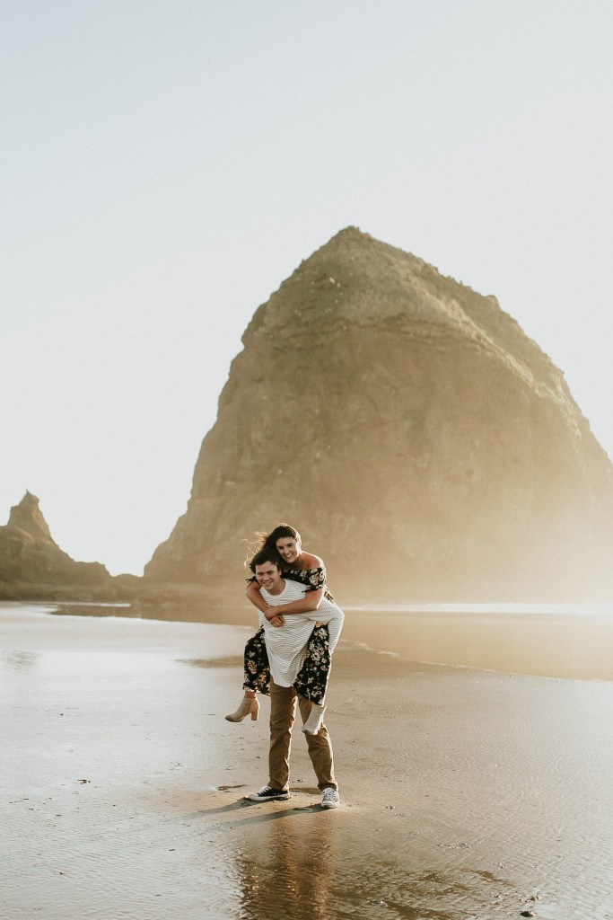 Megan Claire Photography | Oregon engagement and wedding photographer. Cannon beach playful engagement session for adventurous couple