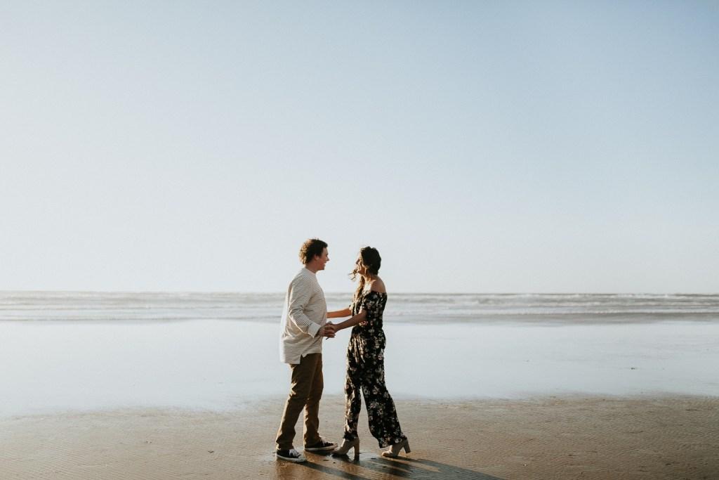 Megan Claire Photography | Oregon engagement and wedding photographer. Cannon beach playful engagement session for adventurous couple